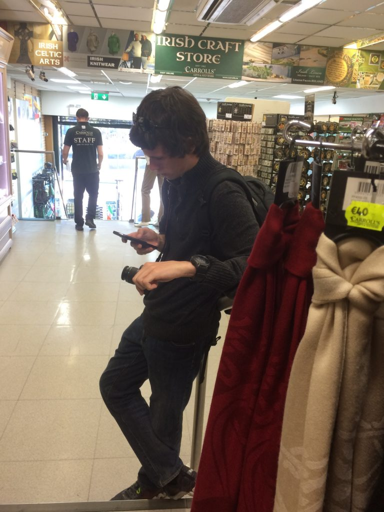 Bonus picture of Corey while I was off souvenir shopping. Typical guy... ;)