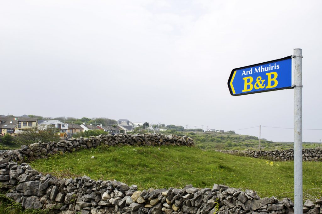 Sign leading to our B&B. If you're ever in the area, definitely stay here. It's quite lovely! Also look at the stone walls. These covered the island!